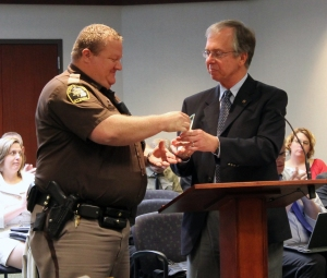 Deputy Terpstra receives his award from County Board of Commissioners Chairman, Jim Holtrop.