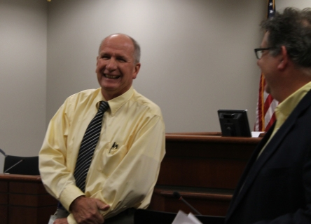 A surprised Mark Bos is paid a visit by Administrator Al Vanderberg who delivered the news of the award.